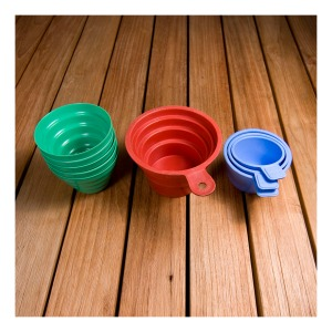 Selex and Helix bakelite picnic and measuring cups