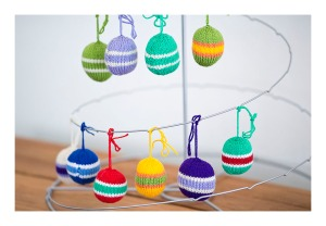 Knitted Christmas baubles, c 2013
