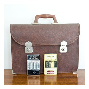 Retro briefcase & vintage calculators